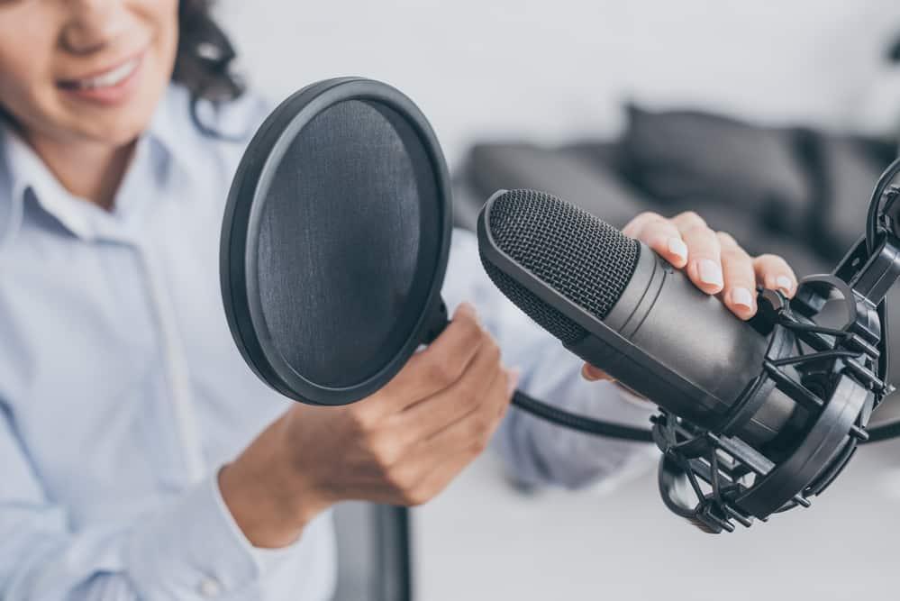 radio host adjusting microphone