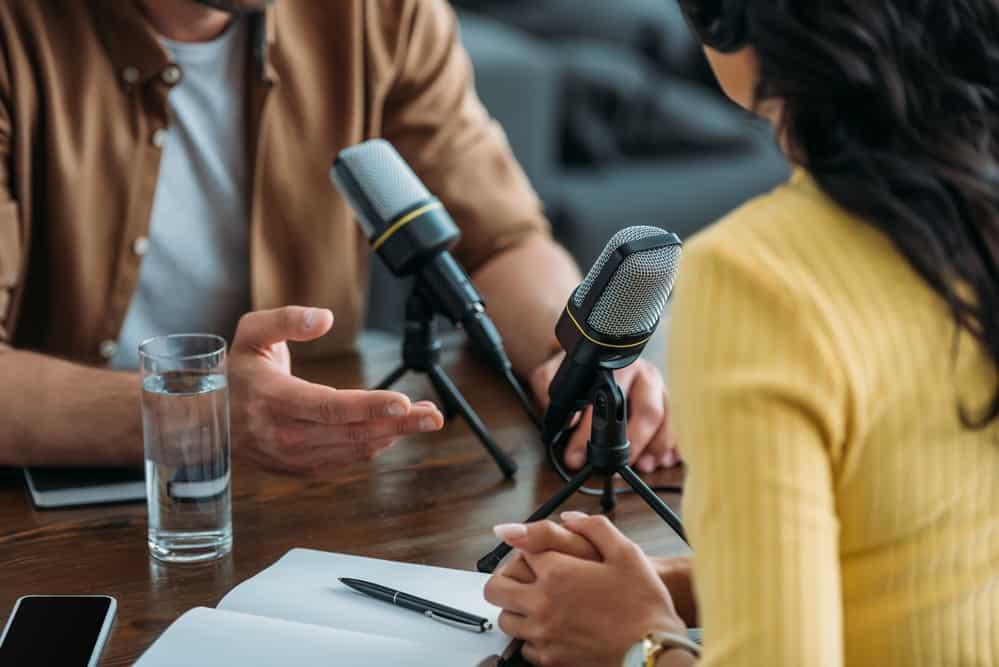 two radio hosts recording podcast
